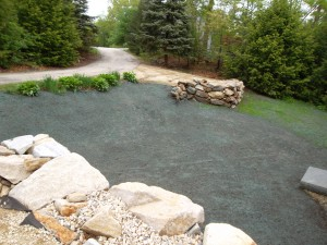 New driveway, rock retaining walls, granite steps, granite landing, and hydro-seed in Raymond, NH